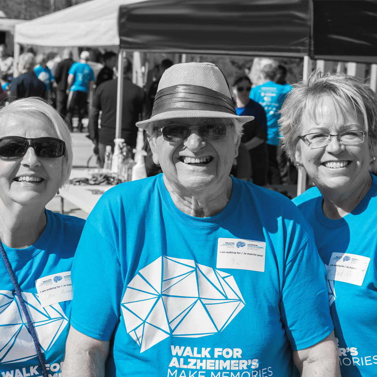 Smiling group pf three seniors at their local Investors Group Walk for Alzheimers