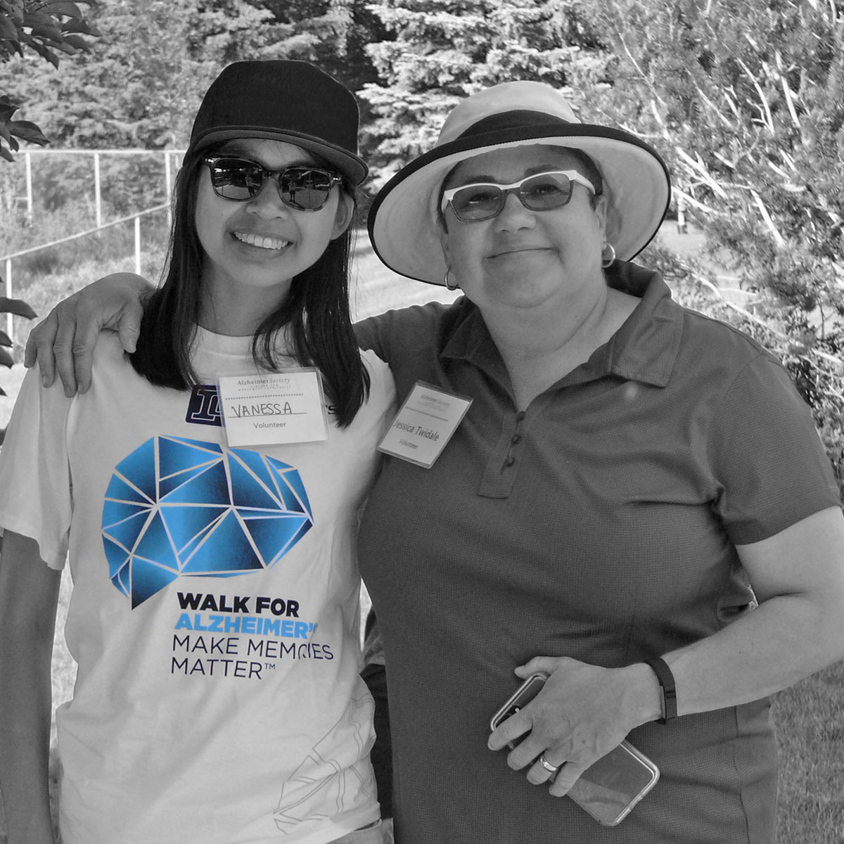 Two participants standing together at their Investors Group Walk for Alzheimer's