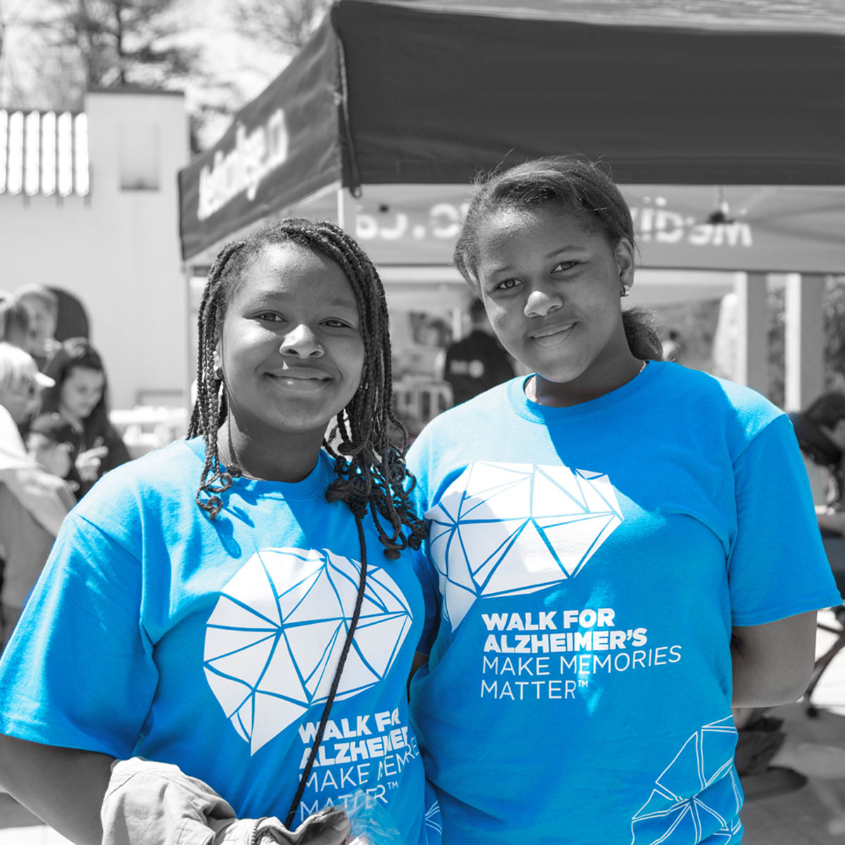 Two young volunteers ready to help at their local Investors Group Walk for Alzheimers